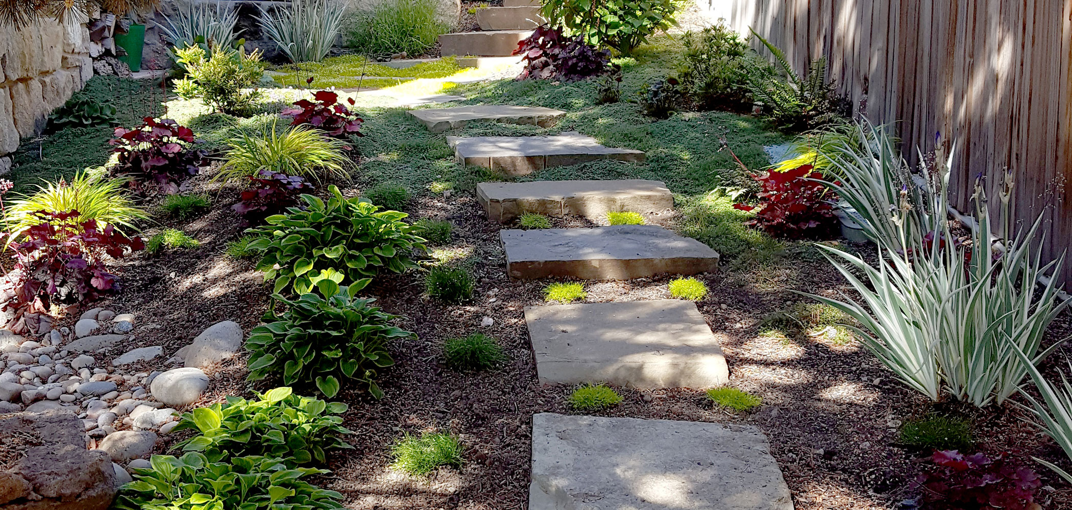 Custom garden and paver walkway installation in Boise, Idaho.
