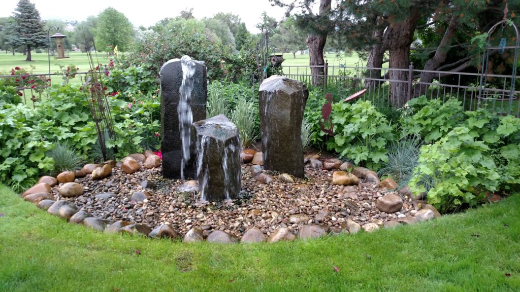 Water fountain pond farwest landscape boise idaho for Backyard pond maintenance