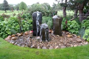 A custom column water feature in a Boise home garden.