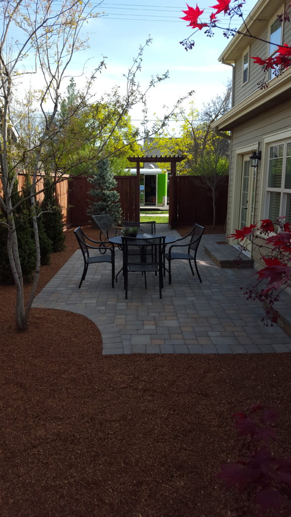 A custom-made paver patio in the backyard of a Boise home.