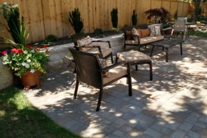 A custom-made, backyard paver patio, with stone planter, in southeast Boise.