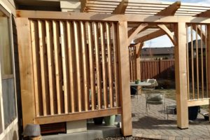 A pergola with wood panel screening at a Boise home.