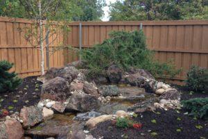 A custom built backyard waterfall feature.