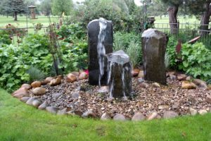 A custom column water feature in a Boise home garden installed by FarWest Landscape.