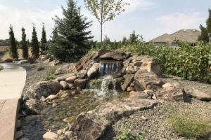 A custom built home garden waterfall feature.